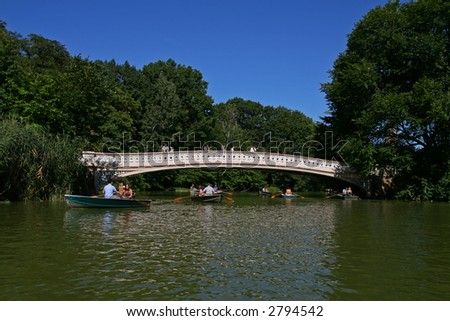 Boating in Central Park on a clear blue summer day - stock photo