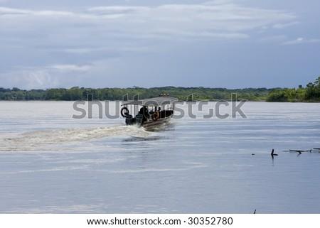 Boating on the Rio Napo River, Ecuadorian Amazon - stock photo