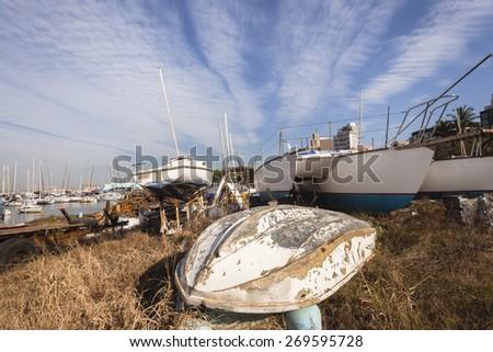 Boats Abandoned Yachts boats abandoned harbor scrap yard. - stock photo