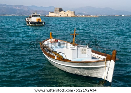 Boats against  Bourtzi fortress in  Nafplion, Greece