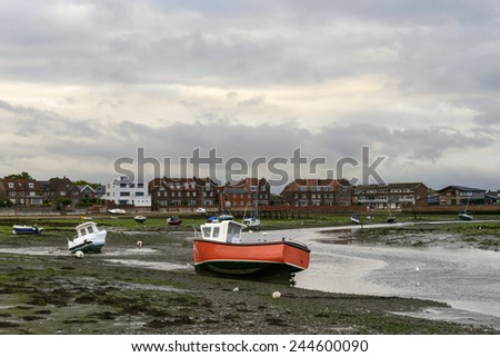 boats aground at Emsworth, Hampshire, view of old boats aground at low tide time in the touristic sea village  - stock photo
