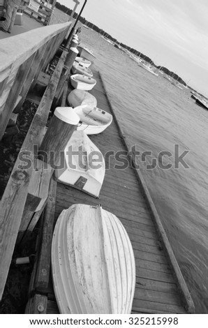 Boats along the dock in Falmouth Maine. Shown in black and white.