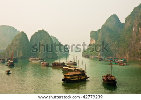 Boats Anchored in Halong Bay, Vietnam. - stock photo