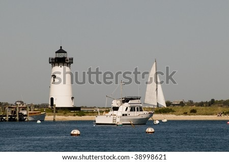 Boats anchored in Nantucket Sound near Edgartown Harbor Lighthouse - stock photo