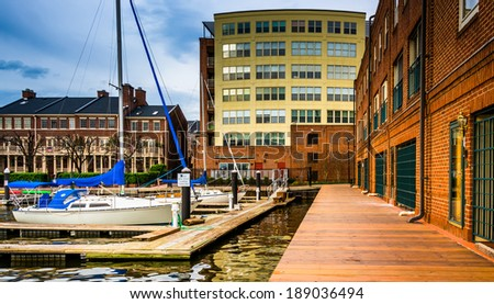 Boats and buildings on the waterfront in Fells Point, Baltimore, Maryland. - stock photo