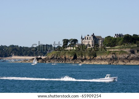 Boats and Chateau at Entry to Harbor of St. Malo, France