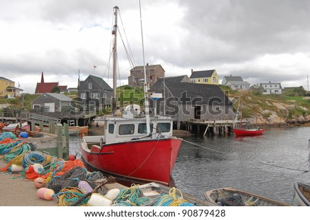 boats and fishing equipment on quayside in canadian fishing village - stock photo