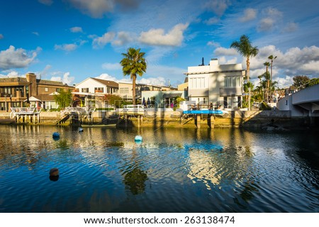 Boats and houses along Beacon Bay, in Newport Beach, California. - stock photo