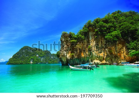 Boats and the clear sea at Phi Phi island, Andaman sea of Thailand. - stock photo