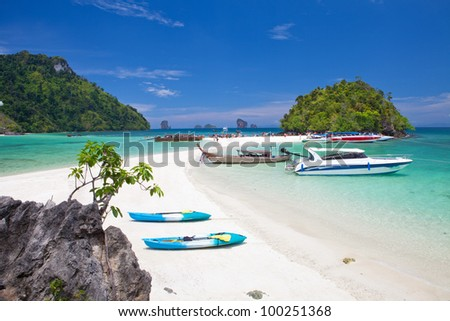 boats and the clear sea Phi Phi south of Thailand - stock photo