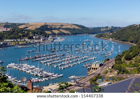 Boats and yachts at Dartmouth Devon on Dart river with blue sky on summer day - stock photo