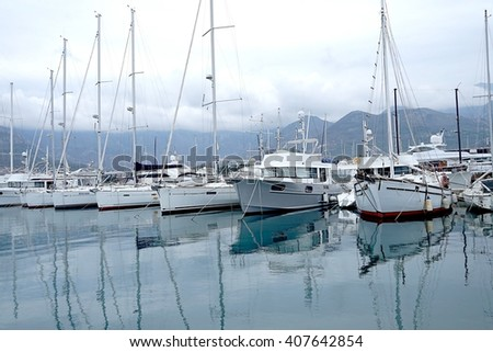 Boats and yachts in a bay of Adriatic sea, Montenegro - stock photo