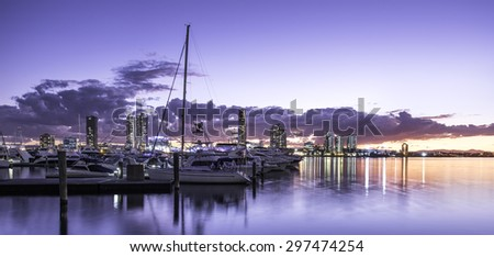 Boats and Yachts in a Bay Overlooking Southport During a Peaceful Sunset, Main Beach, Gold Coast, Queensland, Australia - stock photo