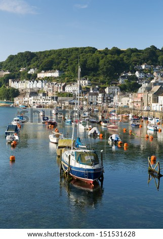 Boats and yachts Looe river Cornwall England UK with blue sea and sky - stock photo