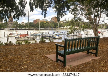 Boats and yachts moored in the Brisbane River by the Brisbane City Botanical Gardens in Queensland Australia.