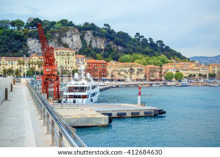 Boats and yachts moored in the port of Nice in a sunny day - stock photo