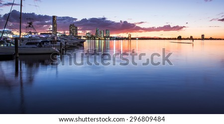 Boats and Yachts Reflecting in the Water and Overlooking Southport During a Beautiful Sunset, Main Beach, Gold Coast, Queensland, Australia - stock photo