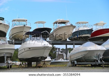 Boats and yachts stand in two rows - stock photo