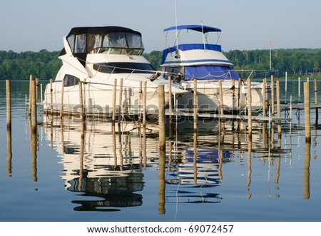 boats at a dock on a lake - stock photo