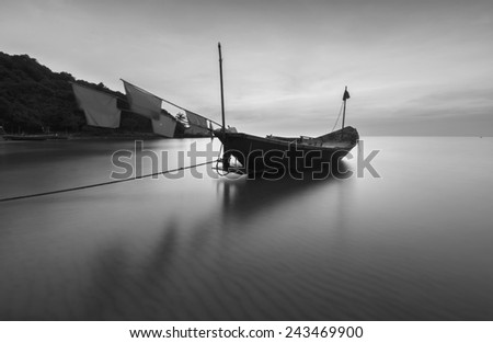 Boats at the beach during sunset black and white tone. - stock photo