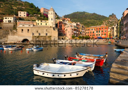 Boats at the harbor on the village of Vernazza in Cinque Terre, Italy - stock photo