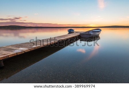 boats at the pier on the lake - stock photo