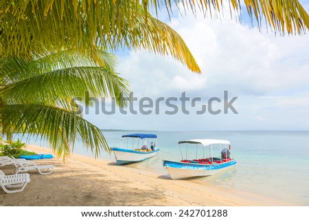 Boats at the Starfish beach, archipelago Bocas del Toro, Panama - stock photo