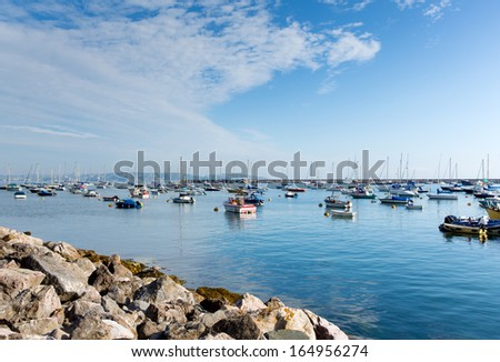 Boats by the yacht club Brixham harbour Devon England UK on a calm summer day with blue sky - stock photo