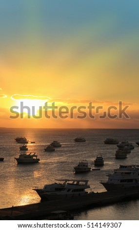 Boats docked in Hurghada Egypt during sunset on the Red Sea