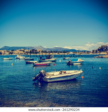 Boats docked near the old fortress on the Greek island of Corfu (Kerkyra). Instagram filter styled - stock photo