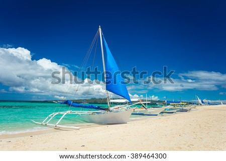 Boats docked on sand beach, Boracay island, Philippines - stock photo