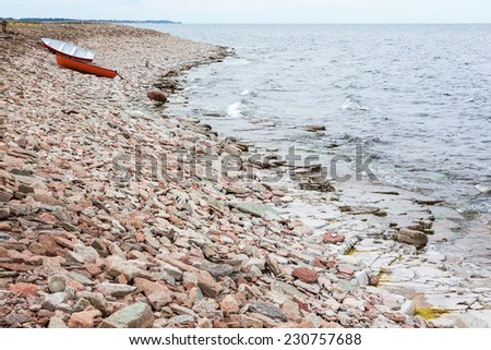 Boats drawn up on the beach - stock photo