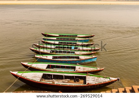 Boats in a row on Ganges River in Varanasi , India. - stock photo