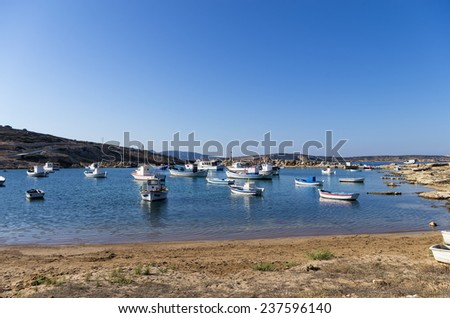 Boats in a small gulf in Ano Koufonisi island, Cyclades, Greece - stock photo