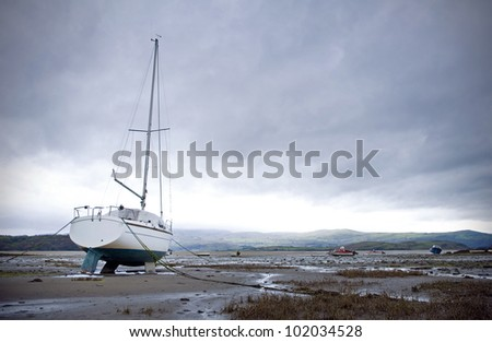 boats in harbor or bay at low tide - stock photo