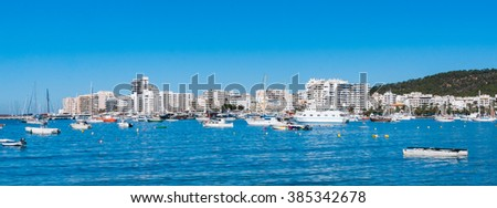 Boats in Ibiza marina harbour in the morning of a warm sunny day.  City of  St Antoni de Portmany, part of the Balearic Islands, Spain.