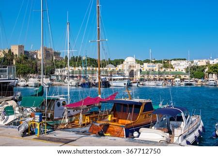 Boats in Mandraki Harbor. Rhodes Town, Rhodes, Greece - stock photo