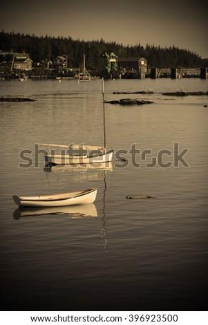 boats in quaint harbor in Maine near Acadia National Park - stock photo