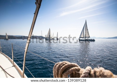 Boats in sailing regatta. - stock photo