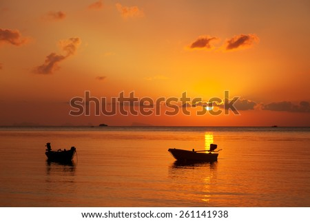 boats in sea at sunset, beautiful sunset