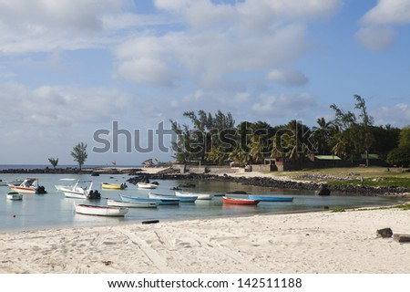 Boats in sea on beach on Mauritius island - stock photo