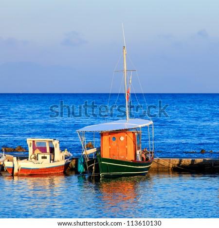 Boats in small harbor near Vlacherna monastery, Kanoni, Corfu, Greece - stock photo