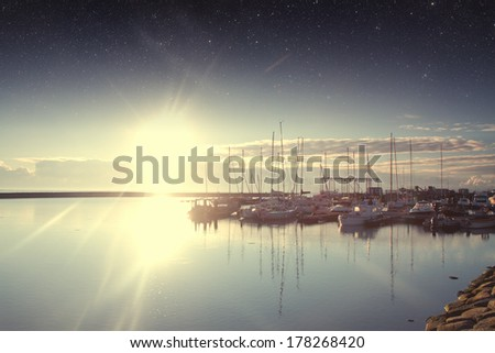 Boats in the harbor at dawn. Elements of this image furnished by NASA  - stock photo