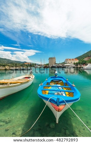 Boats in the harbor in the small port town on the Adriatic Sea
