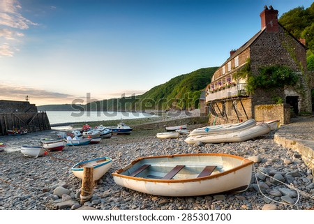 Boats in the harbour at Clovelly an historic fishing village on the Devon Heritage Coast - stock photo