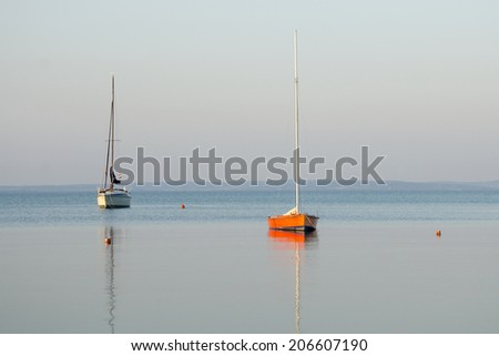 boats in the lake in the morning - stock photo