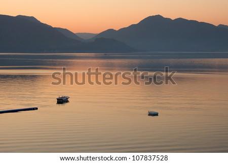 boats in the sea on sunrise  in a calm. Pastel tones. Marmaris. Turkey. - stock photo