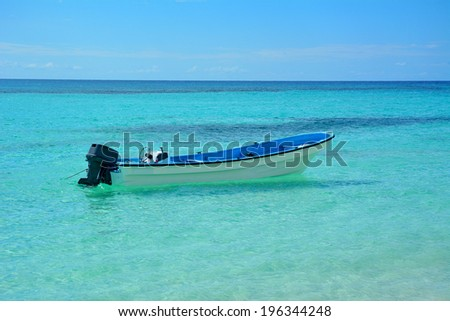 Boats in tropical blue water - stock photo