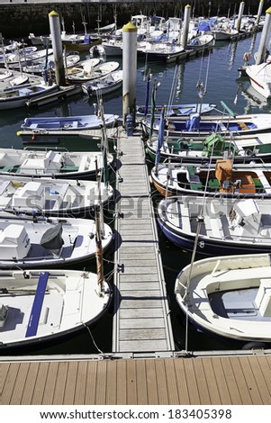 Boats moored at a marine dock, detail of recreational boats on a dock, fishing and fun, sea transport - stock photo