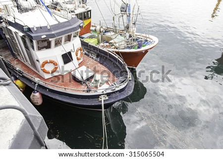 Boats moored at the dock, detail of a ship at sea, maritime transport - stock photo